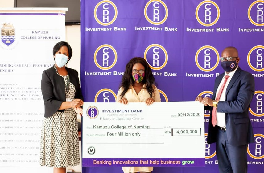 CDH Investment Bank's Chief Business Development Officer, Mr Benison Jambo (R) hands over a donation of K4 million to the Vice Principal of the Kamuzu College of Nursing, Dr Belinda Gombachika (L) and a student representative, Ms Hilda Chinoko (M)