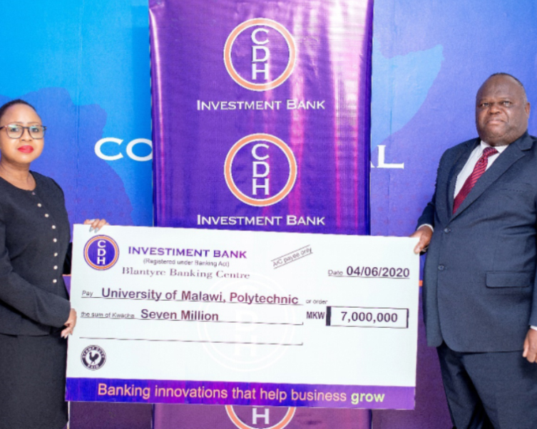 Mrs Beatrix Mosiwa-Ndovi, Chief Finance Officer of CDH Investment Bank hands over a K7 million cheque to Professor Grant Kululanga, Principal of the Polytechnic